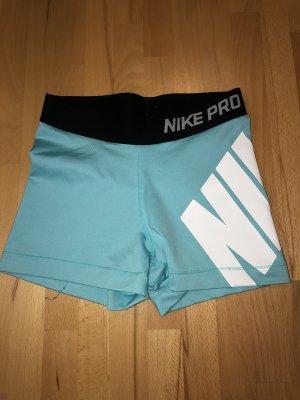 Nike Spodnie sportowe turkusowy