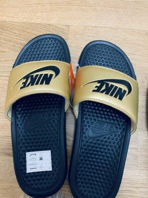 Nike  zwart-goud