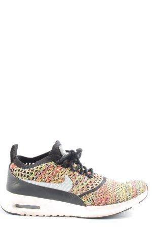 Nike Schnürschuhe schwarz-blassgelb sportlicher Stil