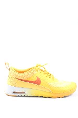 Nike Schnürsneaker blassgelb-rot Casual-Look