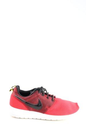 Nike Schnürsneaker rot-schwarz Motivdruck Casual-Look
