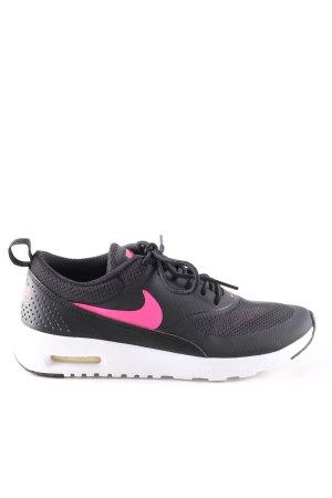 Nike Schnürsneaker schwarz-pink Allover-Druck Casual-Look