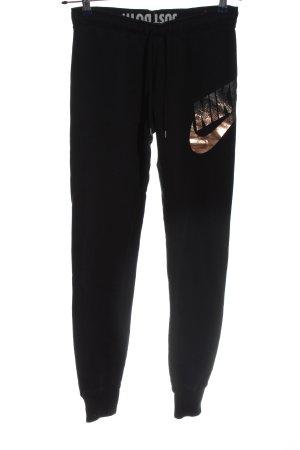 Nike Sporthose schwarz-bronzefarben Motivdruck Casual-Look