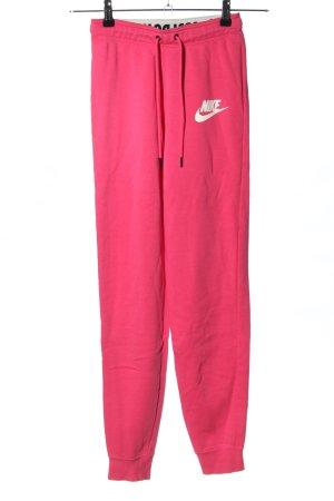 Nike Sweathose pink-weiß Schriftzug gedruckt sportlicher Stil