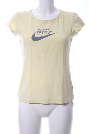 Nike T-Shirt blassgelb-schwarz Schriftzug gedruckt Casual-Look