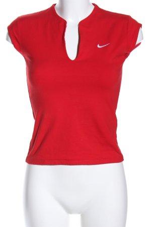 Nike T-shirt col en V rouge imprimé avec thème style décontracté