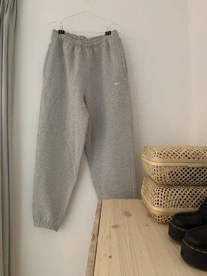 Nike Pantalone fitness grigio chiaro-grigio