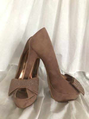 Nude plateau heels
