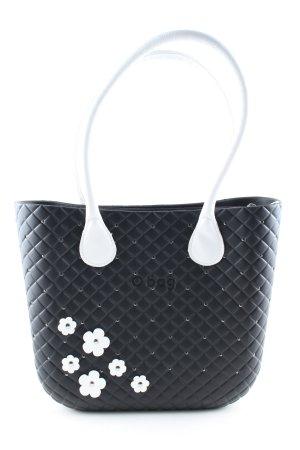 O bag Bolso barrel negro-blanco estampado floral look casual