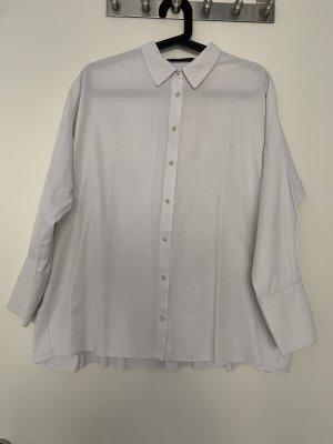 Oberstes Bluse mit Perlenknöpfen