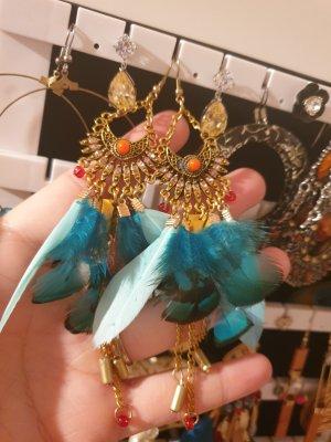 Boucle d'oreille incrustée de pierres multicolore