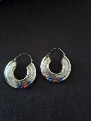 Boucle d'oreille incrustée de pierres argenté