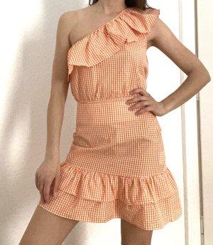 Sukienka na jedno ramię brzoskwiniowy