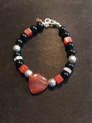 HANDMADE BY GERMANY Bracelet en perles noir-orange foncé