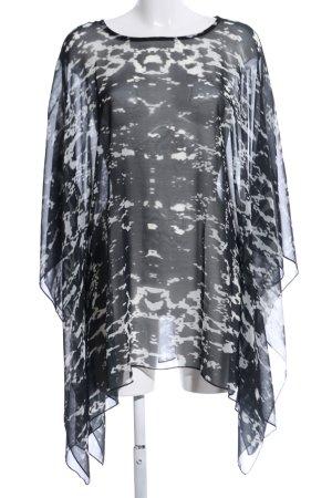 Camisa tipo túnica negro-blanco estampado repetido sobre toda la superficie