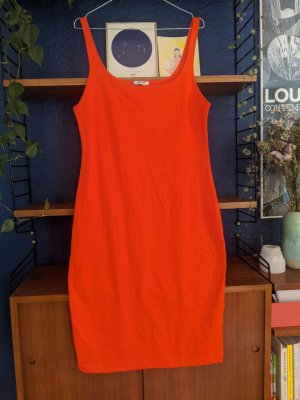 Orange body hugging dress