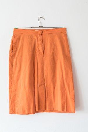 orange-farbener Bleistiftrock