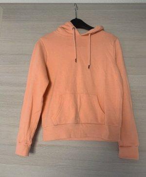 Orangener Pullover