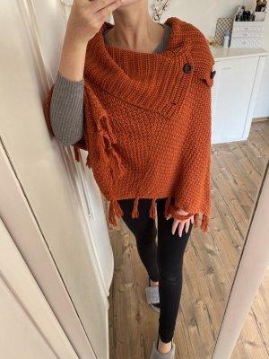 Poncho negro-naranja