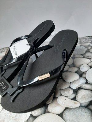 Calvin Klein Sandalias con talón descubierto negro-color plata