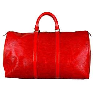 Louis Vuitton Sac de voyage rouge fluo cuir