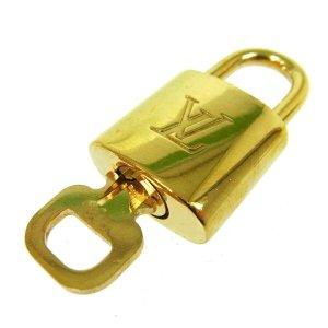 Louis Vuitton Bolso de viaje color oro metal