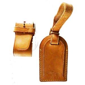 Louis Vuitton Kledingzak zandig bruin Leer