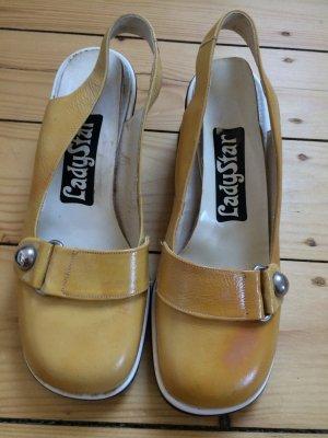 Tacones sin talón marrón arena-amarillo pálido