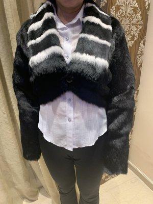 Veste de fourrure noir-blanc