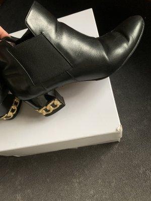 Casadei Halfhoge laarzen zwart-goud
