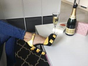 Chanel Décolleté con plateau oro-nero Pelle