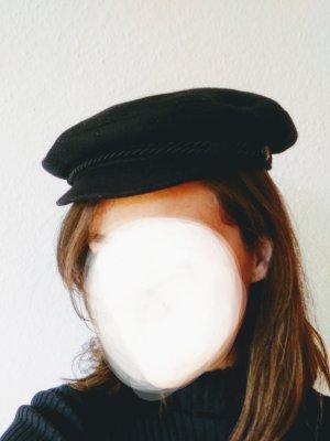 Cappello con visiera blu scuro