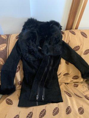 Abrigo de piel negro Cuero
