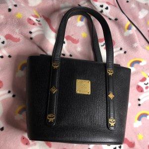 MCM Bolso negro-color oro