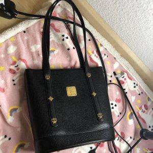 MCM Bolso negro-color oro Cuero