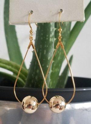 Ovale 18k Gold-Ohrhänger mit goldener Perle