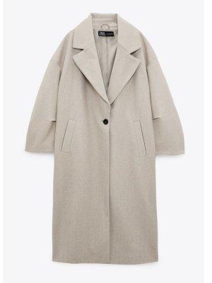 Oversize Mantel mit etikett