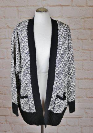 Veste tricotée en grosses mailles noir-blanc cassé