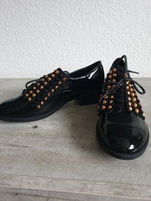 Zapatos estilo Oxford negro-color oro