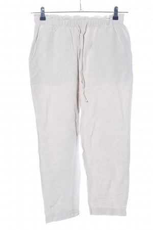 Oysho Pantalón tobillero blanco puro look casual