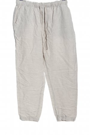 Oysho Pantalón de lino gris claro look casual