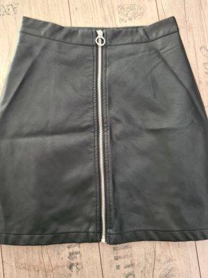 Page one Falda de cuero negro
