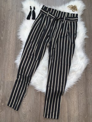 H&M Pantalón de cintura alta negro-color oro tejido mezclado