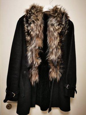 Abrigo de piel negro-gris claro