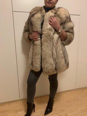 Manteau de fourrure beige clair