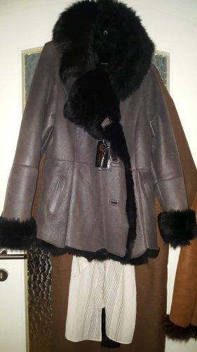 Manteau de fourrure noir fourrure