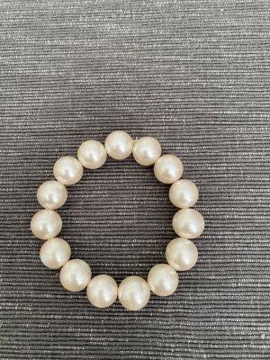 Bracelet en perles rosé