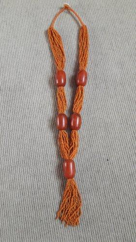 Collana di perle arancione