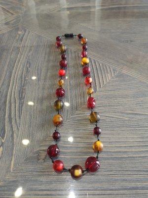 Collier de perles orange doré-rouge fluo