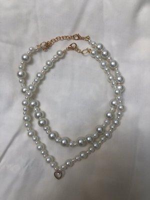 Perlenketten mit Herzanhänger